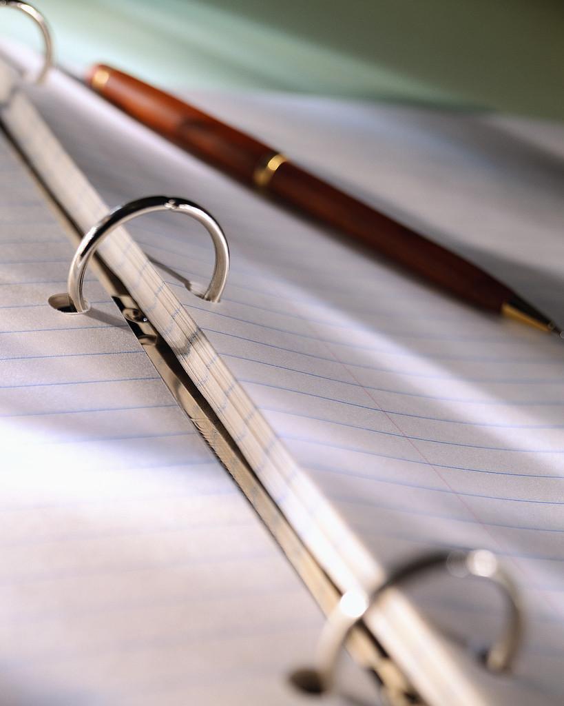 Pen on Notepaper in Ring Binder